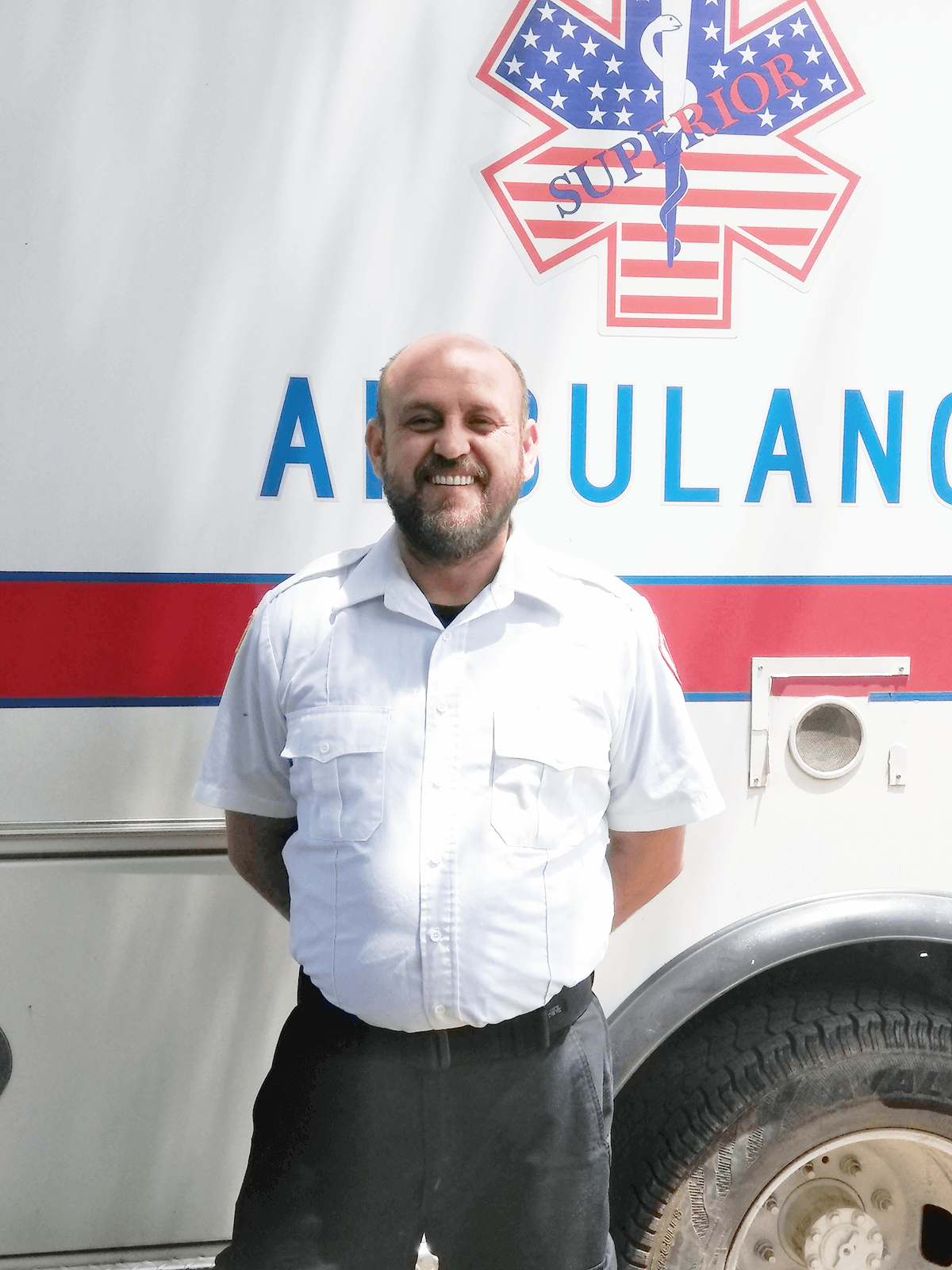 James Certain pictured standing in front of an ambulance